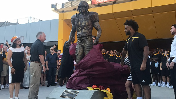 The bronze Pat Tillman statue that stands at the point where players enter Sun Devil Stadium is one of the ways Arizona State feels it honors the late soldier. (Photo by Omar Soussi/Cronkite News)