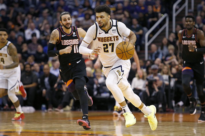 Denver Nuggets guard Jamal Murrey brings the ball up ahead of Phoenix Suns' Ricky Rubio (11) during the second half of a game Saturday, Feb. 8, 2020, in Phoenix. (Ralph Freso/AP)