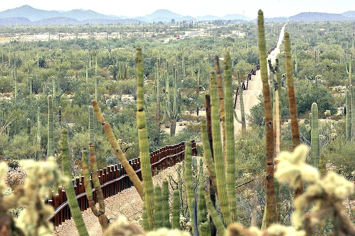 his Feb. 17, 2006 file photo, shows a fence separating Organ Pipe Cactus National Monument, right, and Sonyota, Mexico, running through Lukeville, Arizona. (AP Photo/Matt York, File)