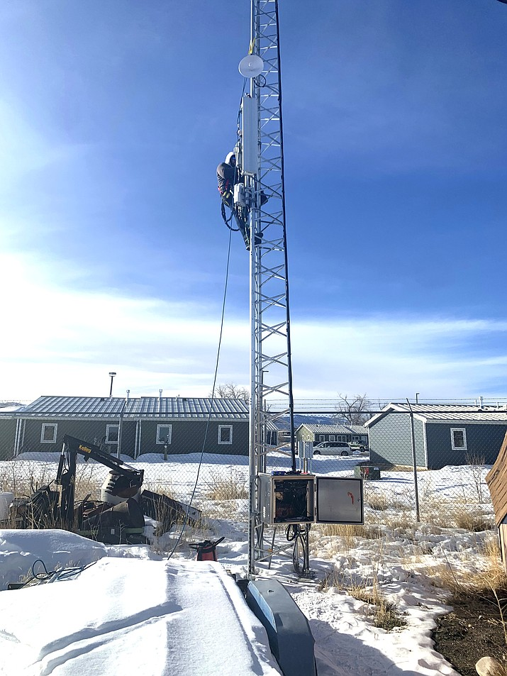 Patrick Lawson, executive manager of the Northern Arapaho Tribal Industries/Wind River Internet, tests broadband equipment in Fort Washakie on the Wind River Indian Reservation in Wyoming Jan. 17. (Mariel Triggs via AP)
