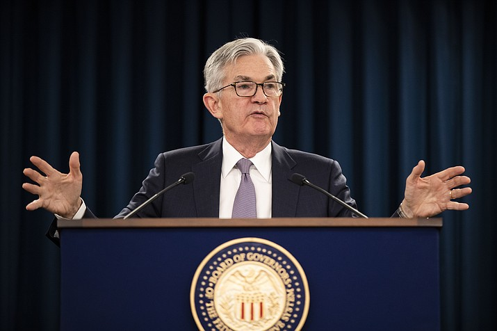 In this Jan. 29, 2020 photo, Federal Reserve Chair Jerome Powell speaks during a news conference following the Federal Open Market Committee meeting in Washington. The Federal Reserve believes that downside risks to the U.S. economy have lessened with the easing of trade tensions and better prospects for global growth. But officials note a concern that possible spillovers from a deadly virus in China represent a new threat. (Manuel Balce Ceneta/AP, File)