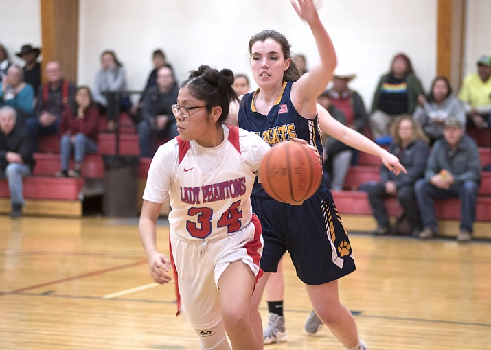 Maria Dugi drives the ball past a Joseph City defender during the Feb. 6 game against Joseph City. (Veronica Tierney/WGCN)