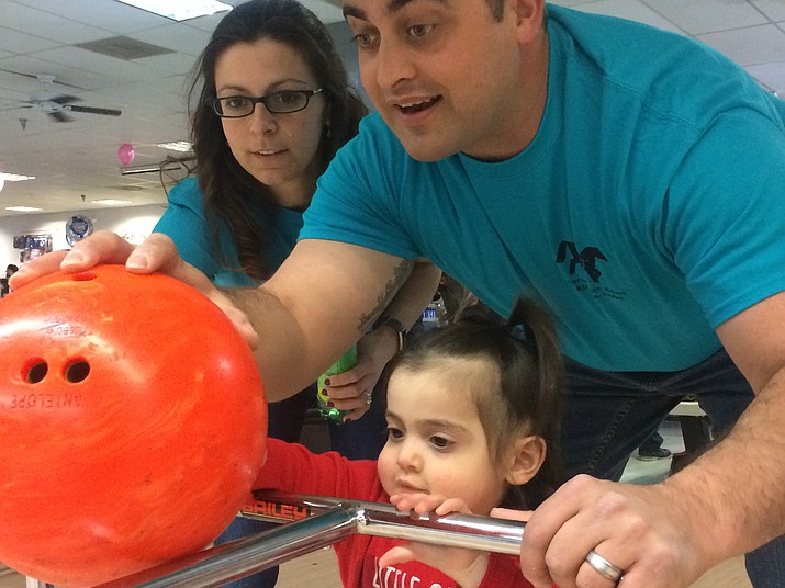 Lindy and Aaron Walters help daughter Loretta Walters bowl at the 16th annual Horses with H.E.A.R.T.'s 16th annual Bowl-A-Thon at Antelope Lanes in Prescott Valley on Saturday, Feb. 16, 2019. (Jason Wheeler/Review, file)