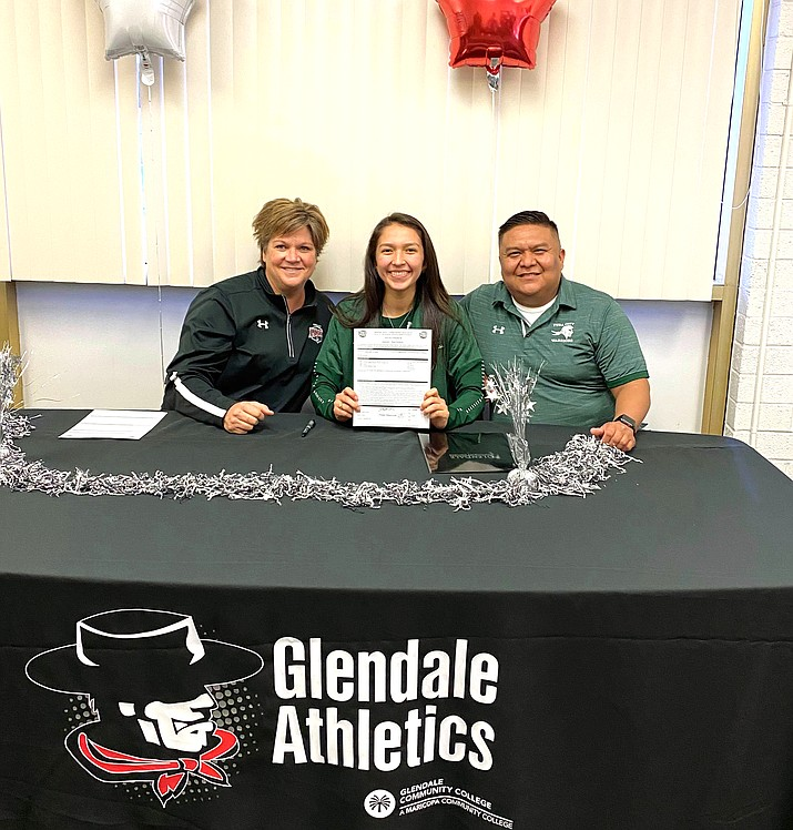 Jayda Chee, a senior at Tuba City High School, signs a letter of intent Jan. 15 to play collegiate volleyball at Glendale Community College. From left, Coach Lisa Stuck, volleyball coach at Glendale Community College, Jayda Chee and Harlan Barlow, head volleyball coach at Tuba City High School. (Submitted photo)