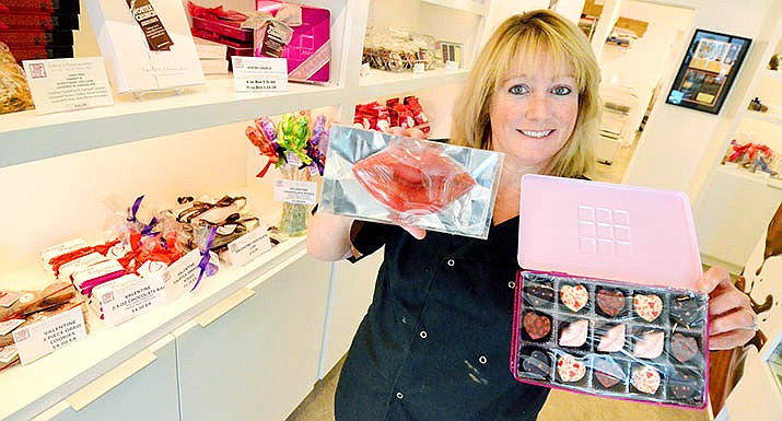 Colleen Corson shows off some of Gayle's Chocolates. VVN/Vyto Starinskas