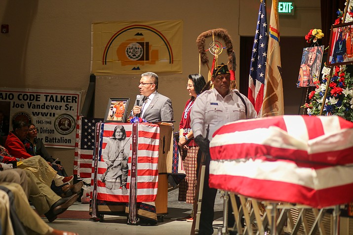 Vice President Myron Lizer presents the proclamation and a Navajo Nation flag to the family of Code Talker Vandever. (Photo/Navajo Nation)