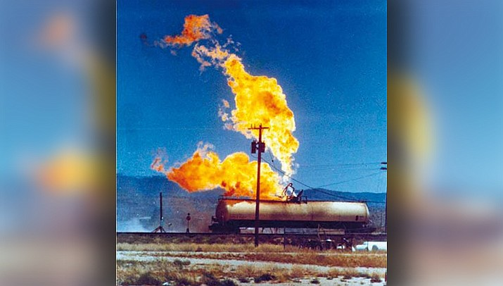 The Silent Night basketball game at Lee Williams High School in Kingman will honor the 11 Kingman firefighters who died when this railroad car containing propane caught fire and exploded on July 5, 1973. (Miner file photo)