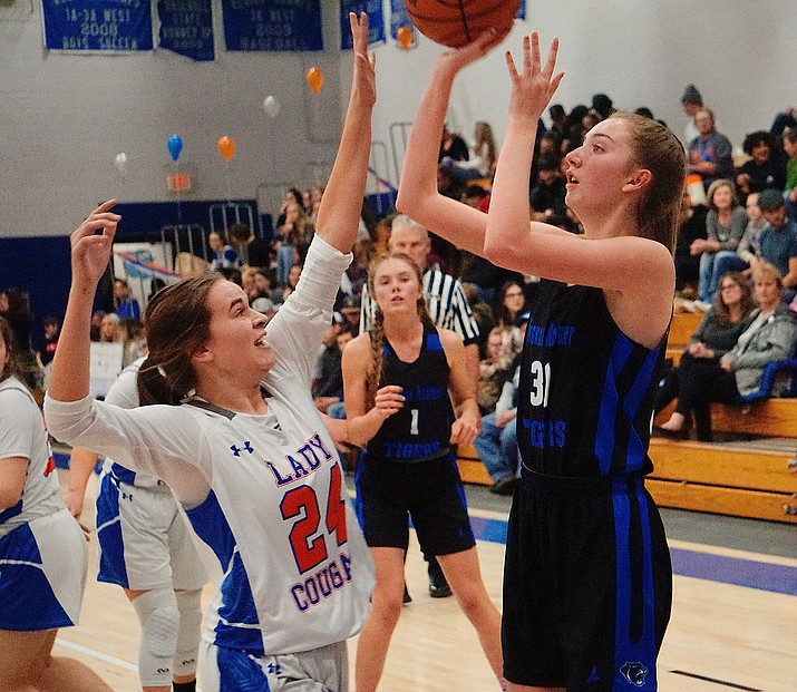 Academy senior Faith Edwards attempts a shot Tuesday in a 31-25 loss to Chino Valley. (Photo by Aaron Valdez/For the Miner)