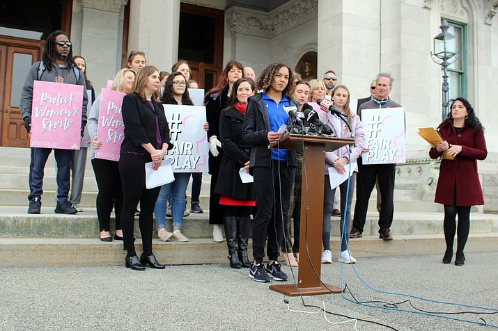 Danbury High School sophomore Alanna Smith speaks during a news conference at the Connecticut State Capitol in Hartford, Conn., Wednesday, Feb, 12, 2020. Smith, the daughter of former Major League pitcher Lee Smith, is among three girls suing to block a state policy that allows transgender athletes to compete in girls sports. (AP Photo/Pat Eaton-Robb)