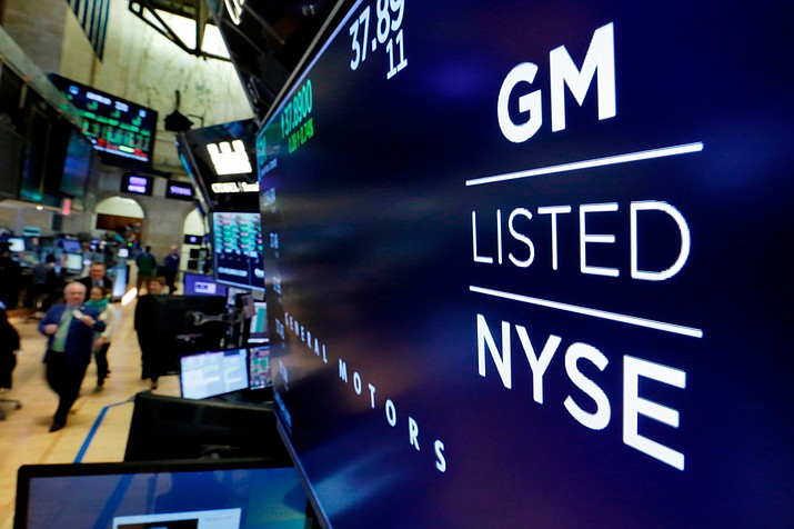 In this April 23, 2018 photo, the logo for General Motors appears above a trading post on the floor of the New York Stock Exchange. Despite a 40-day strike by factory workers and slumping sales in the U.S. and China, General Motors still made money in 2019. The company posted a $6.58 billion profit for the year, but that was down almost 17% from 2018. (Richard Drew/AP, File)