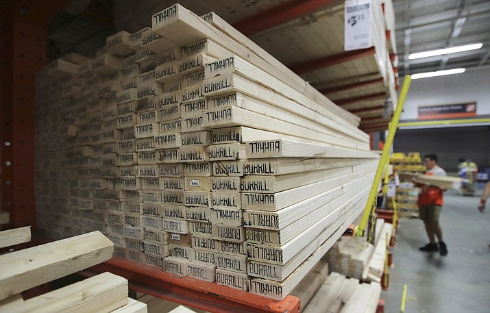 In this July 11, 2019 photo, lumber is stacked at a store in Londonderry, N.H. Don't let your desire to upgrade your home downgrade your home's market value. Before you make a renovation fantasy a reality, consider whether the project will pay off when you're ready to sell. (Charles Krupa/AP, File)