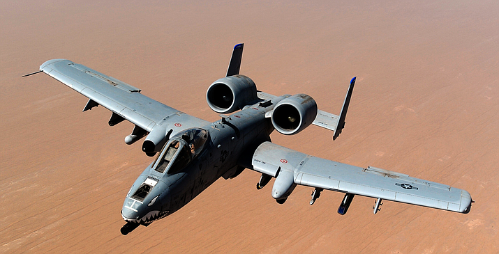 An A-10 Thunderbolt II from the 74th Fighter Squadron at Moody Air Force Base in Georgia flies over Afghanistan in this 2011 photo. The Pentagon plans to retire 44 A-10s in fiscal 2021, which has put some Arizona lawmakers on alert. (Photo by Master Sgt. William Greer/U.S. Air Force)