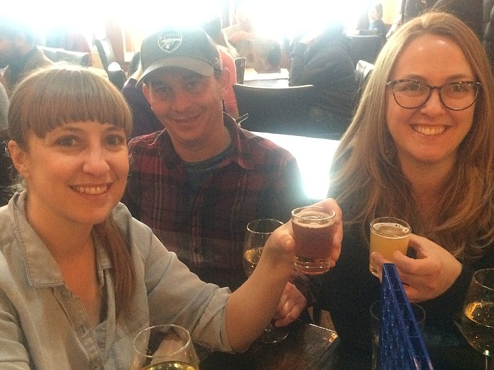 Cate Wilson, Mickey Sarkett and Emilie Wilson enjoy some brews in The Raven Cafe during the first ever Northern Arizona Craft Beer Crawl Saturday, Feb. 16. (Jason Wheeler/Courier)