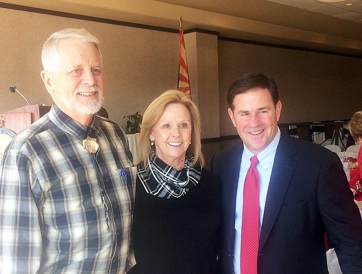 Carl and Marsha Mueller pose with Gov. Doug Ducey at the Prescott Resort on Thursday, Feb. 13, 2020, after Ducey briefed local leaders and business owners on the State of the State. (Tim Wiederaenders/Courier)