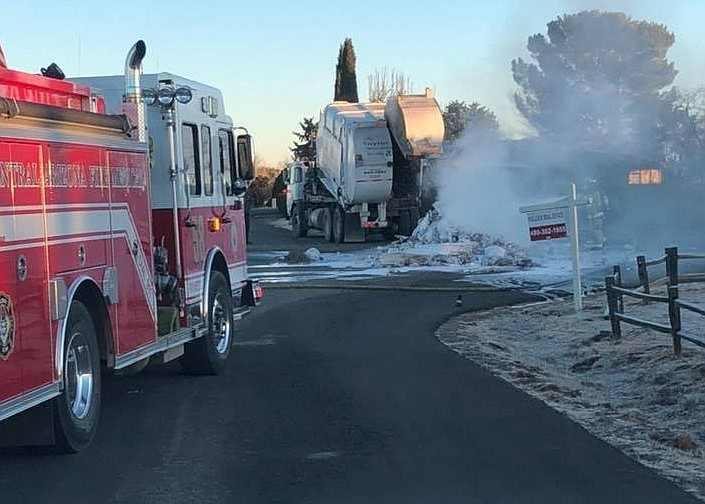 A load of flaming trash is extinguished after a garbage truck dumped its contents on Ramada Drive in Prescott Valley Thursday morning, Feb. 13, 2020. (CAFMA/Courtesy)