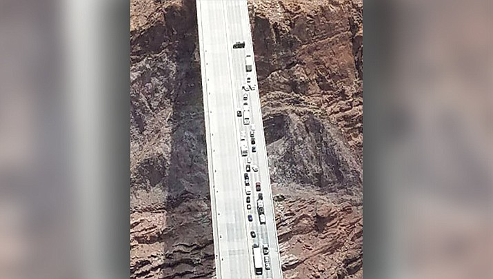 In this aerial photo provided by Arizona Department of Public Safety, Matthew Phillip Wright's tactical-style vehicle blocks the southbound lanes on the Mike O'Callaghan-Pat Tillman Bridge near the Hoover Dam on Friday, June 15, 2018. (Arizona Department of Public Safety)