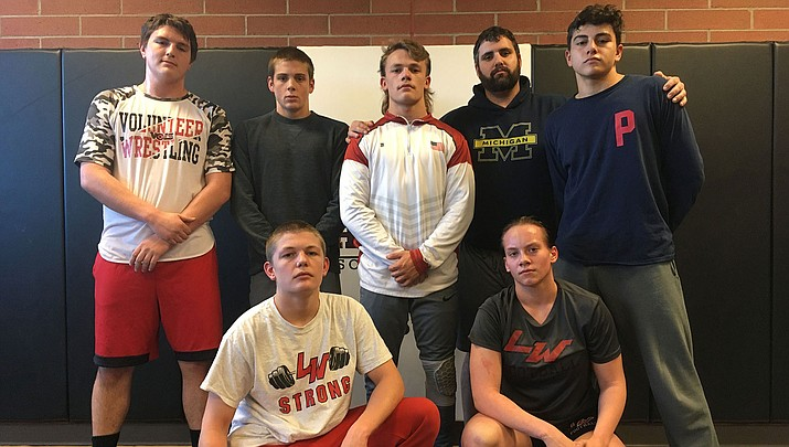 The Vols will have six wrestlers compete Friday and Saturday in Prescott Valley. Back row, from left, Zach Allen, John Chandler, Jimmy Wayman, coach Dan Ondrejka and Christian Marzo. Front row, from left, Payton Wayman and Stephanie Broadbent. (Photo by Beau Bearden/Kingman Miner)