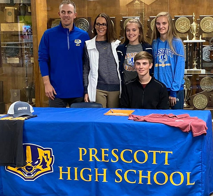 Prescott senior Carter Libis, bottom right, poses for a photo with his family after signing his letter of intent to play golf for Ottawa University on Thursday, Feb. 13, in the front lobby of Prescott High School. A transfer student from South Dakota, Libis broke school records for lowest score in 18 holes with a 66 and lowest score in nine holes with a 31. He also finished 11th overall at the state match, which was the best performance by a Badger since 1997.  (Dan Osterloh/Courtesy)
