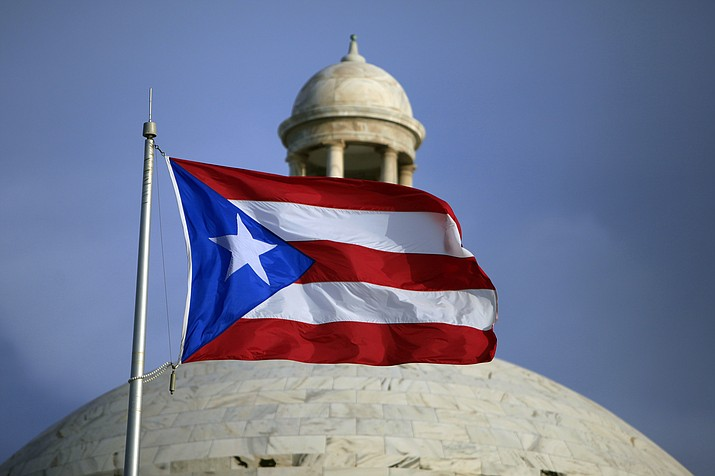 In this July 29, 2015 file photo, the Puerto Rican flag flies in front of Puerto Rico's Capitol as in San Juan, Puerto Rico. A senior Puerto Rico official said Tuesday, Feb. 11, 2020, that the island's government has lost more than $2.6 million after falling for an email phishing scam. (Ricardo Arduengo/AP photo)