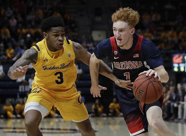 Arizona's Nico Mannion, right, drives the ball against California's Paris Austin (3) in the first half of a game Thursday, Feb. 13, 2020, in Berkeley, Calif. (Ben Margot/AP)