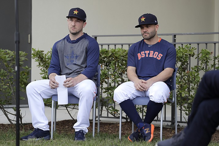 Houston Astros infielder Alex Bregman, left, and teammate Jose Altuve sit in chairs as the wait to deliver statements during a news conference before the start of the first official spring training practice for the team Thursday, Feb. 13, 2020, in West Palm Beach, Fla. (Jeff Roberson/AP)