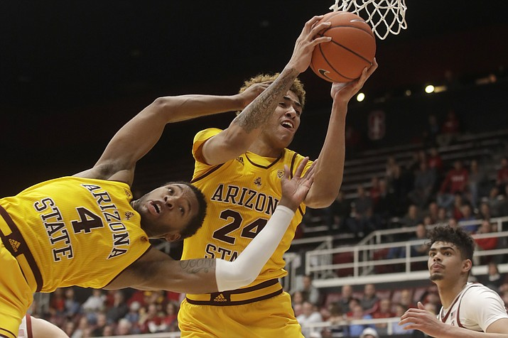 Arizona State forward Jalen Graham (24) grabs a rebound over forward Kimani Lawrence (4) during the second half of the team's game against Stanford in Stanford, Calif., Thursday, Feb. 13, 2020. (Jeff Chiu/AP)