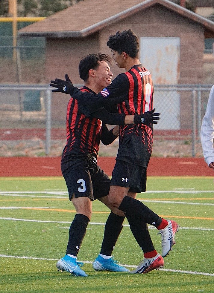 Bradshaw Mountain defender Alan Pulido, left, celebrates with forward A.J. Villafana after Villafana scored a goal during a game against Mingus on Wednesday, Jan. 29, 2020, at Bob Pavlich Field in Prescott Valley. (Aaron Valdez/Courier, file)