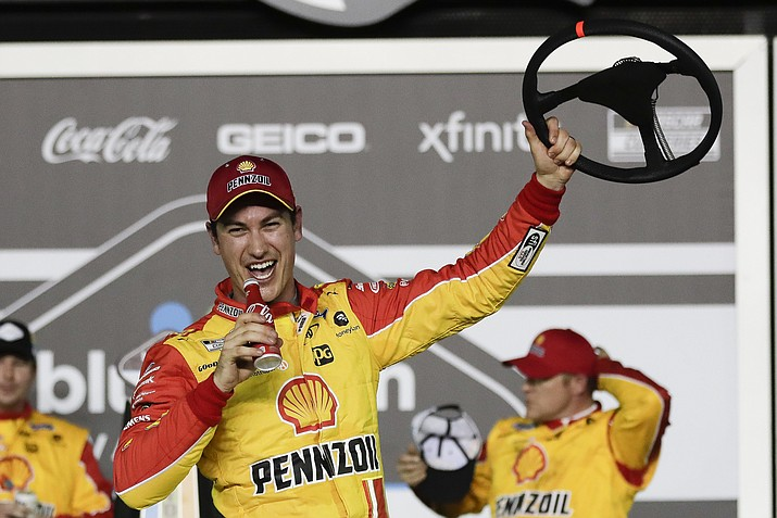 Joey Logano celebrates in Victory Lane after winning the first of the two NASCAR Daytona 500 qualifying races at Daytona International Speedway, Thursday, Feb. 13, 2020, in Daytona Beach, Fla. (John Raoux/AP)