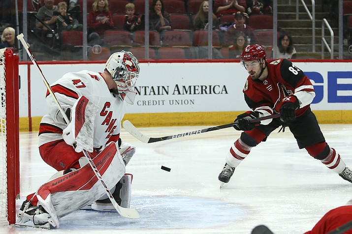 Carolina Hurricanes goaltender James Reimer (47) makes a save on a shot by Arizona Coyotes right wing Conor Garland (83) during the second period of a game Thursday, Feb. 6, 2020, in Glendale. (Ross D. Franklin/AP)