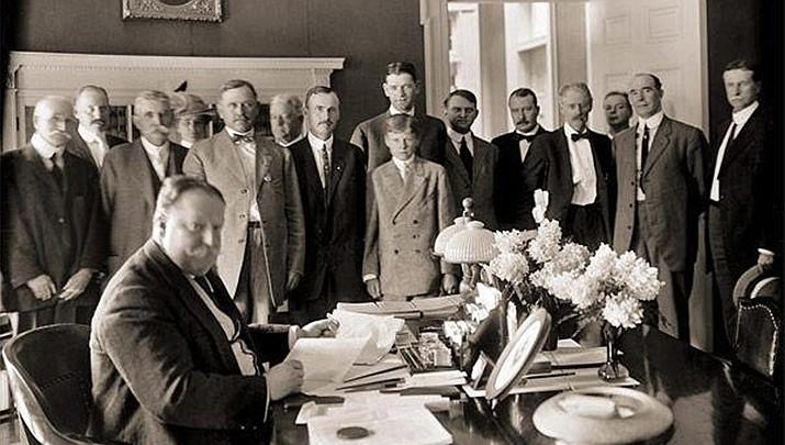 President William Howard Taft signs the bill admitting Arizona into the nation, Feb. 14, 1912. (Photo courtesy of Arizona Historical Society)