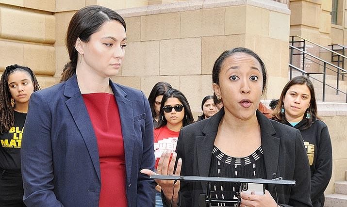 Attorneys Heather Hamel, left, and Aya Saed discussing in December the lawsuit they filed accusing members of the Arizona Legislature attending a conference of violating the state's Open Meeting Law. (Capitol Media Services photo by Howard Fischer)