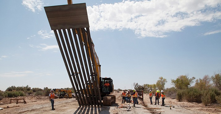 The Army Corps of Engineers installs border fencing near Yuma in September, construction funded in part by $3.6 billion shifted from the Pentagon construction projects last year. The administration now wants to divert another $3.8 billion, this time from jets and other hardware and from the National Guard. (Photo by Vincent Mouzon/Army Corp of Engineers)