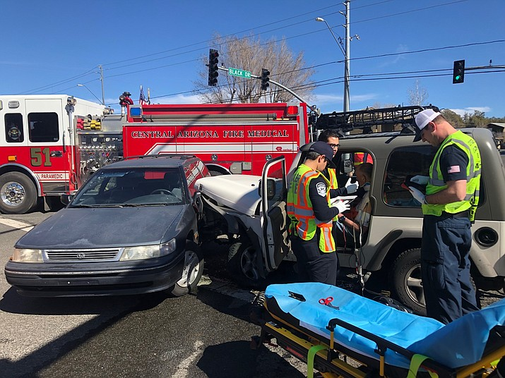 A 63-year-old man in a white Jeep is helped by members of the Central Arizona Fire and Medical Authority on Friday, Feb. 14, 2020, after he drove into traffic and sideswiped a car before hitting another vehicle head on. The driver was transported to YRMC with unknown injuries. (Prescott PD/Courtesy)