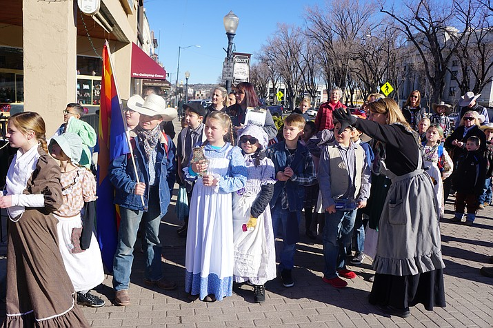 Chino Valley teacher Brenda Hubbard, right, points out features of historic downtown Prescott to her Del Rio Elementary School fourth-grade class. The students were on a field trip on Thursday, Feb. 13, 2020, in celebration of Arizona's Statehood Day, Feb. 14. (Cindy Barks/Courier)