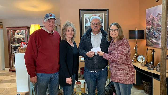 Pictured are Don and Annie Fuller of Annie's Art Attic, left, and David Hunter of Our Daily Bread, center. He is being presented with a $500 check from Art Attic board member Jean Amico. (Courtesy photo)