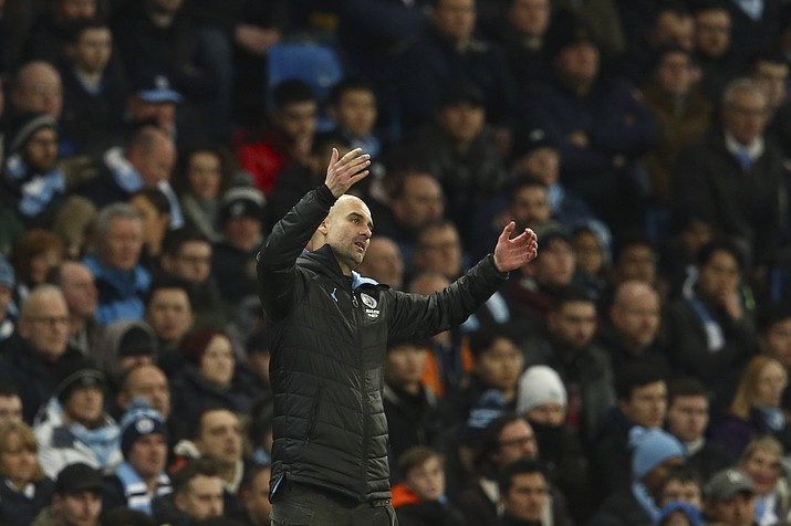 Manchester City's head coach Pep Guardiola gestures during the English League Cup semifinal second leg match between Manchester City and Manchester United at Etihad stadium in Manchester, England, Wednesday, Jan. 29, 2020. (Dave Thompson/AP)