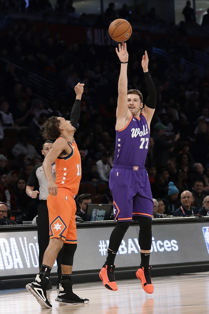 World's Luka Doncic, right, of the Dallas Mavericks, shoots over U.S. guard Trae Young, of the Atlanta Hawks, during the first half of the NBA Rising Stars game in Chicago, Friday, Feb. 14, 2020. (Nam Y. Huh/AP)
