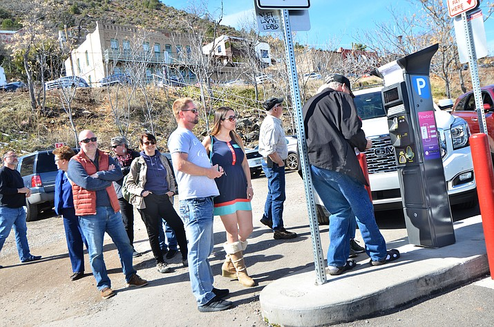 A group of tourists wait to feed the Jerome parking kiosk on Friday afternoon. The kiosks are generating revenue for the town to fix infrastructure. VVN/Vyto Starinskas