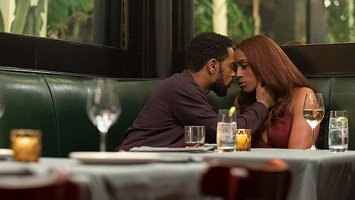 """LaKeith Stanfield and Issa Rae are shown in a scene from """"The Photograph."""" (IMDb photo)"""