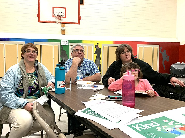 "A family looks on as groups present ideas to encourage students to be smart, alert, strong, kind and brave when on the internet during ""Be Internet Awesome"" Feb. 12 at Grand Canyon School. The event was sponsored by the Parent Teacher Association to help students and parents develop safe and healthy internet habits. (Photo/Grand Canyon School)"