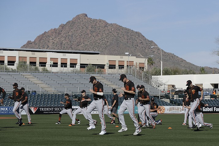 The San Francisco Giants run during spring training baseball practice, Friday, Feb. 14, 2020, in Scottsdale, Ariz. The Chicago Cubs and San Francisco Giants are pushing ahead with pay raises for minor league players this season, days after Major League Baseball mandated salary bumps beginning in 2021.(Darron Cummings/AP)