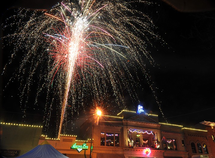 Fireworks light the sky during the annual New Year's Eve Whiskey Row Boot Drop in Prescott. Prescott was recently named one of the top Western towns by a magazine. (Les Stukenberg/Courier file)