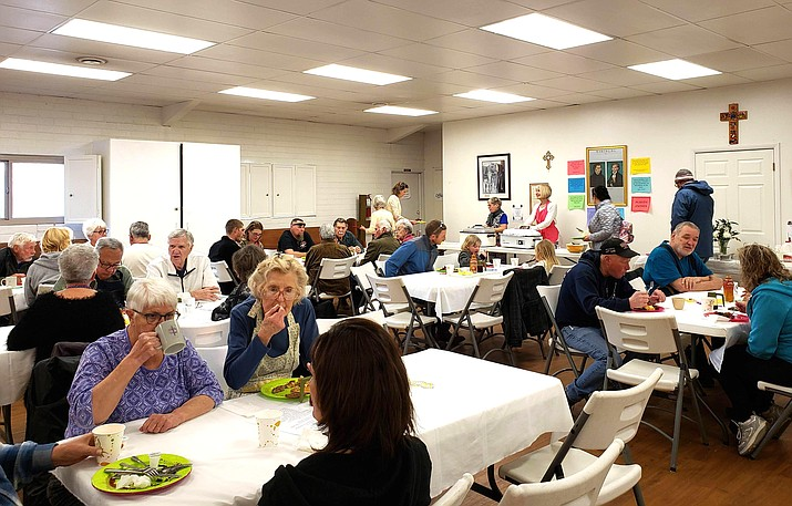 A crowd gathers at St. John's Episcopal-Lutheran church in 2019 to visit and enjoy the community pancake breakfast. (Submitted photo)