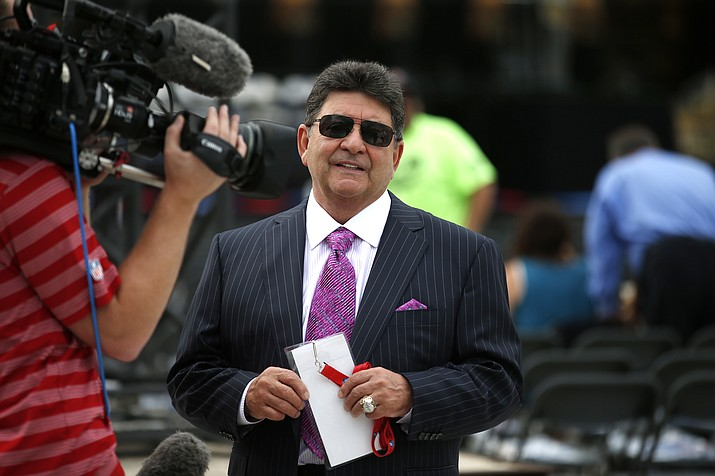 In this Aug. 8, 2015, file photo former owner of the San Francisco 49ers Edward DeBartolo, Jr., is interviewed before the Pro Football Hall of Fame ceremony at Tom Benson Hall of Fame Stadium in Canton, Ohio. President Donald Trump pardoned DeBartolo, who is convicted in gambling fraud scandal. (Gene J. Puskar, AP File)
