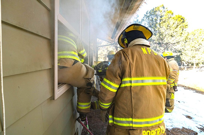 Firefighters practice VEIS training (Vent, Enter, Isolate, Search) in a housing unit at Grand Canyon National Park in February during interagency training. (Photo/Grand Canyon National Park Emergency Services & Law Enforcement)