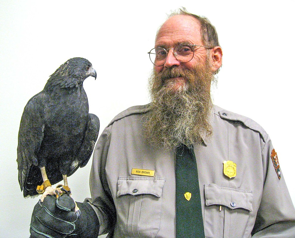 Ron Brown holds a falcon during a Celebrate Wildlife Day at Grand Canyon National Park. Brown was honored Feb. 12 by park employees. (Mike Quinn/NPS)