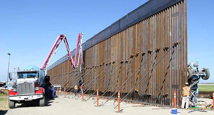 Army Corps of Engineers contractors pour foundations for new sections of border fence near Otay Mesa, California, in March 2019. The Department of Homeland Security said it will waive contracting and other regulations along the southern brder to speed wall construction. (Photo by Brooks Hubbard IV/U.S. Army Corps of Engineers)