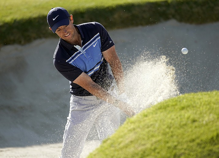Rory McIlroy, of Northern Ireland, hits out of a bunker onto the 17th green during the final round of the Genesis Invitational at Riviera Country Club, Sunday, Feb. 16, 2020, in the Pacific Palisades area of Los Angeles. (Ryan Kang/AP)