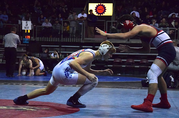 Camp Verde junior Dade Woodard wrestles in the Division IV 126 pound fifth/sixth place match at the state championships in Prescott Valley on Saturday night. VVN/James Kelley