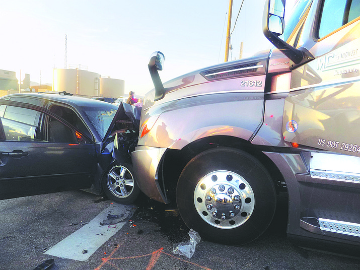 The driver of the sedan, a 40-year-old Kingman man, sustained life-threatening injuries in this collision with a semi-truck at Castle Rock Road and Gordon Drive on Monday, Feb. 17, 2020. Police said the driver of the car was not wearing a seatbelt, and was catapulted into the windshield of the car. (Kingman Police Department photo)
